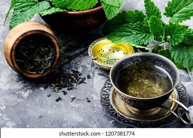 Fresh natural green melissa herbal tea in cup.eHealthy herbal tea
