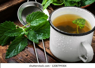 Fresh natural green melissa herbal tea in cup.Relaxation healthy beverage