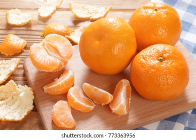 Fresh natural mandarins on wooden table