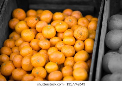 Fresh nectarines citrus in a wooden crate