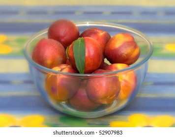 fresh nectarines in a glass bowl