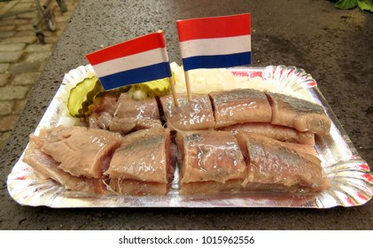 Fresh new herring with pickle and onions in Amsterdam market