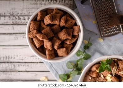 Fresh nougat yogurt with almonds flakes, chocolate crisp and dark chocolate