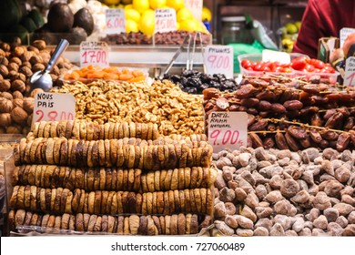 Fresh nuts and dried fruits display with price at public market in Barcelona, Spain.