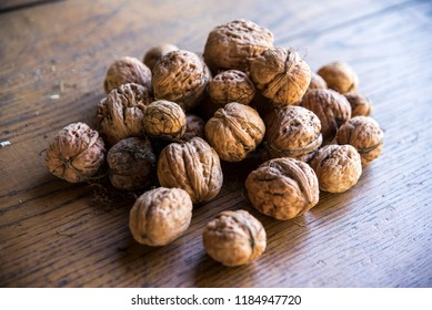 Fresh nuts on the table - Shutterstock ID 1184947720