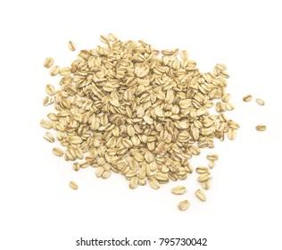 Fresh oat flakes isolated on white background.