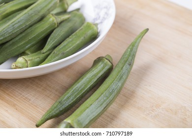 Fresh okra on the wooden table.
