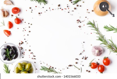 Fresh olives, cherry tomatoes, herbs end spices scattered on white background, copy space, top view. Food background concept, recipe mockup