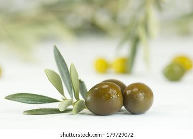 fresh olives on white background