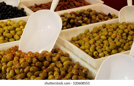 fresh olives under oil for sale at the stall in southern Italy