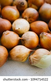 Fresh onion bulbs on wooden background . Vegetables for a healthy diet. Bulb onion is rich in vitamins, useful spring. Onion peel on a wooden background. ingredient for a healthy salad