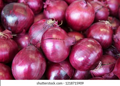 Fresh onions group background.Ripe organic onions.Onions in market.Organic Allium,Top view,flay lay on the shelf in gourmet market.