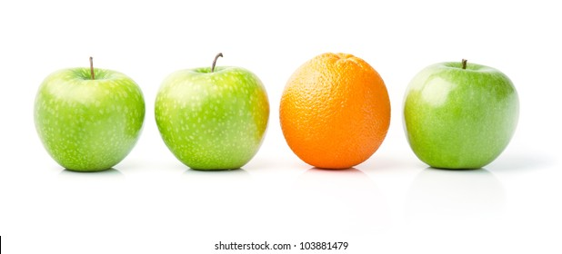 Fresh Orange Among Green Apples, Isolated on White