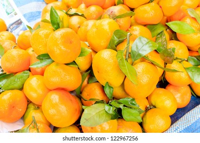 Fresh orange in the background with leaves.