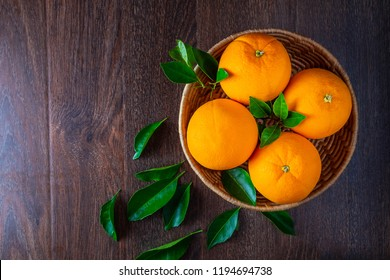 Fresh orange in the basket top view