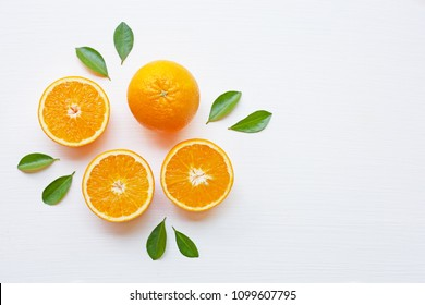 Fresh orange citrus fruit with leaves isolated on white background.  Top view
