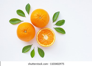 Fresh orange citrus fruit  with leaves on white  background. Top view