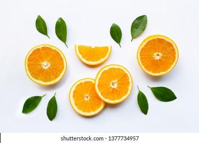 Fresh orange citrus fruit with leaves on white background