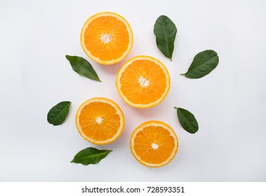 Fresh orange citrus fruit on  white wooden background. Top view