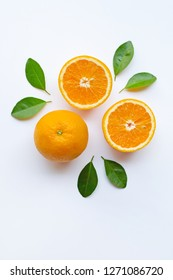 Fresh orange citrus fruit slices with leaves on white background.  Top view