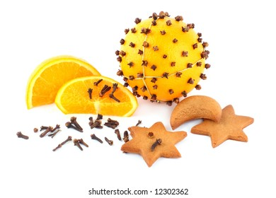 fresh orange and clove in the form of pomander attached to the gold string with cakes and slice of orange