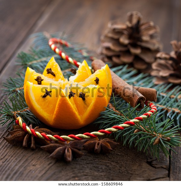 fresh orange with cloves and decoration