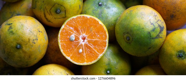 Fresh Orange cut half on pile of oranges / select focus and adjustment size for banner, cover, header