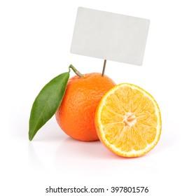 fresh orange fruit with blank price tag isolated on white background