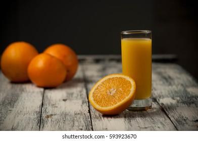 fresh Orange fruit cut and orange juice on wooden table background,