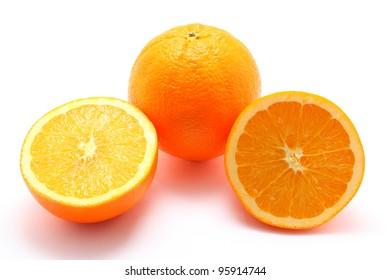 Fresh orange fruit and half