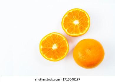 fresh orange fruits cut half isolated on white background