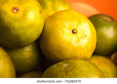 Fresh orange fruits in piles