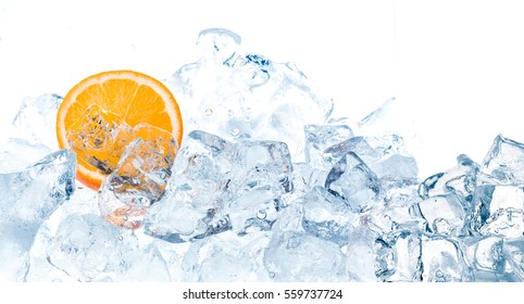 Fresh orange in ice cubes background.