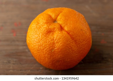 Fresh orange isolated on wooden board
