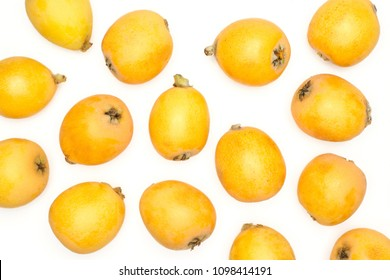 Fresh orange Japanese loquats flatlay isolated on white background
