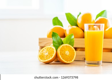 Fresh orange juice for drink in glass on wooden table - Healthy food concept