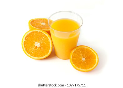 Fresh orange juice in a glass. Round orange slices on a white background. Citrus tropical fruit background. Bright food. Dietary vitamin nutrition. A lot of vitamin C.