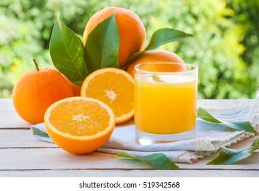 Fresh orange juice with  oranges fruit outdoors