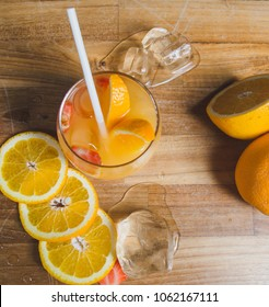 Fresh orange juice with paper bio eco-friendly straw on a wooden background. Not plastic straw