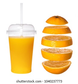 Fresh orange juice in a transparent glass with a tube. Falling sliced orange on a white background. Creative concept with flying fruit