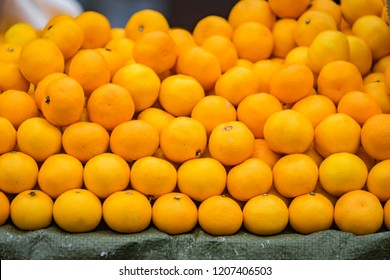 Fresh orange , lime or lemon for sale in local market which are place on stall. Agriculture and fruits product. Selected close focus.