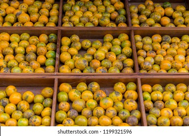 Fresh orange in modern trade supermarket. Mixed with orange and green colors. Fruits have not perfect skin. Concept if outside is not good but inside may be good. Everything has its own value.