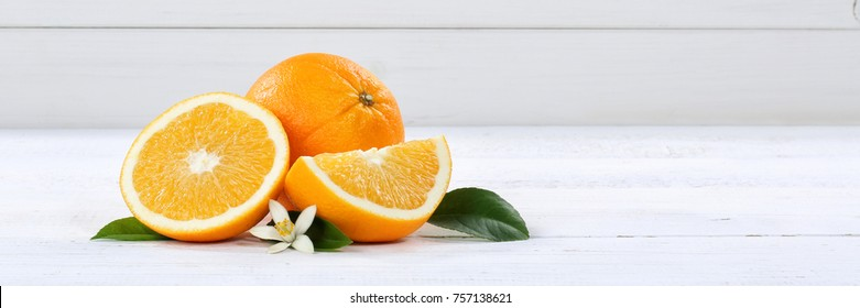 Fresh orange oranges fruit fruits banner copyspace on a wooden board wood