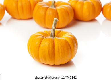 Fresh Orange Organic Pumpkin against a background