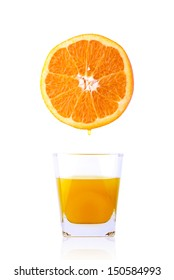 Fresh orange over glass of orange juice