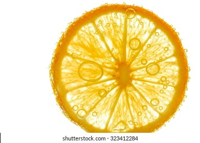 Fresh orange slice in water with bubbles on white background