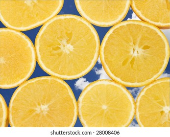 Fresh orange slices, laid out to form a pattern. A sky background has been added to add to the freshness appeal.