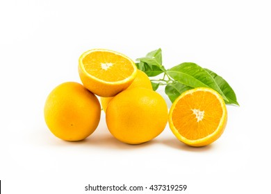 Fresh oranges isolated with leafs on white background. Group of Objects.