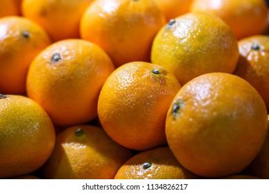 fresh oranges on market stall