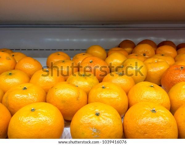 Fresh oranges on shelf at supermarket